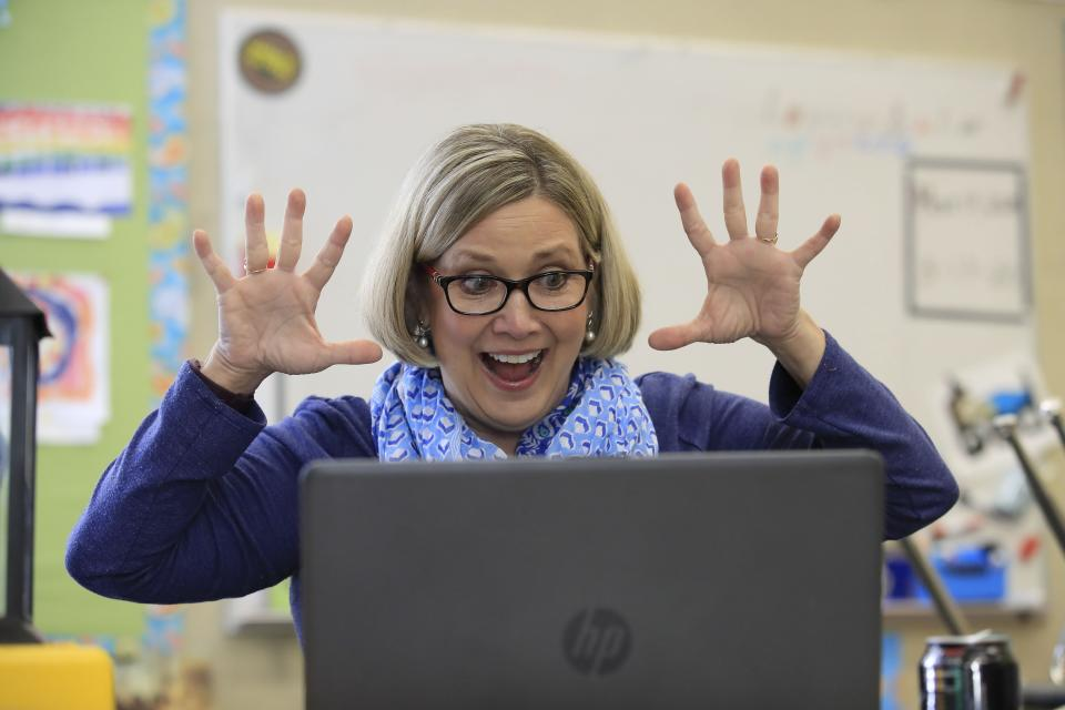 LOUISVILLE, KENTUCKY - APRIL 15:  Joanne Collins Brock , a second grade teacher at St Francis School (Goshen) , teaches online in her empty classroom on April 15, 2020 in Goshen, Kentucky.  Brock has been teaching daily online to her students because of the closure of schools in Kentucky due to the Coronavirus (COVID-19) pandemic. (Photo by Andy Lyons/Getty Images)