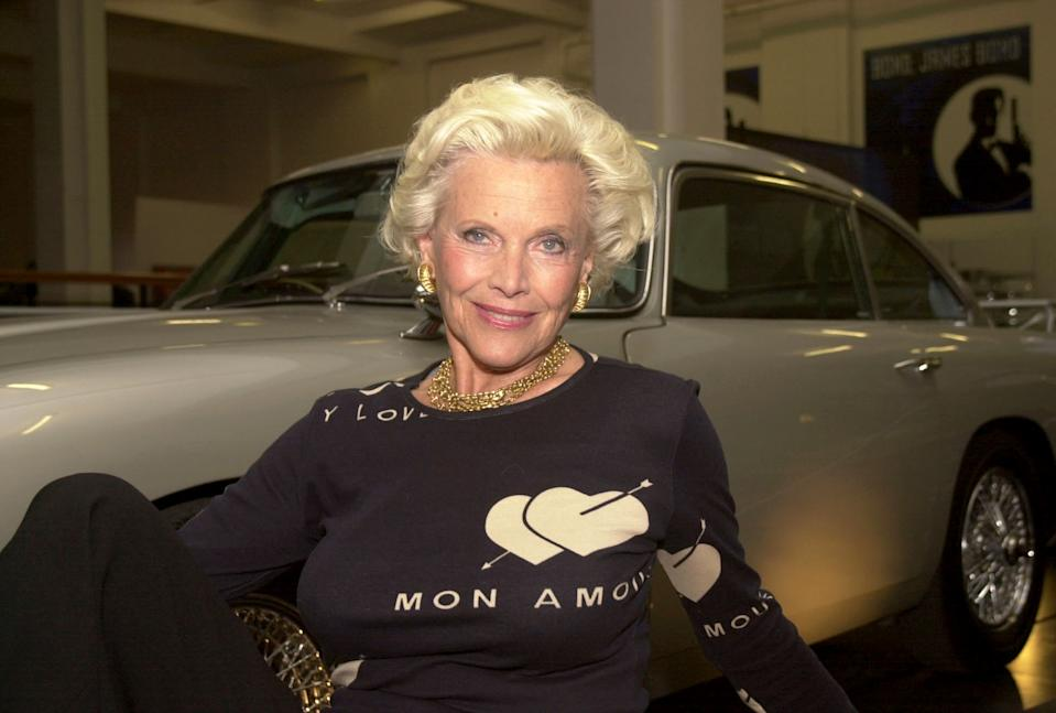 Former Bond-girl Honor Blackman, who played Pussy Galore in Goldfinger, with James Bond's Aston Martin DB5 during the opening of 'Bond, James Bond' at the Science Museum in London.    *...The exhibition claims to be biggest James Bond exhibition ever staged and features a huge collection of original objects, images, concept drawings, storyboards and costume designs.  21/12/03: Honor Blackman, who, it was revealed, declined a CBE in the Queen's birthday honours of 2002. The actress was one of 300 top stars who were today named in a secret list of celebrities who have turned down the honours system.   (Photo by Yui Mok - PA Images/PA Images via Getty Images)