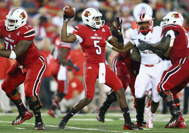 LOUISVILLE, KY - OCTOBER 10: Teddy Bridgewater #5 of the Louisville Cardinals throws a pass during the game against the Rutgers Scarlet Knights at Papa John's Cardinal Stadium on October 10, 2013 in Louisville, Kentucky. (Photo by Andy Lyons/Getty Images)