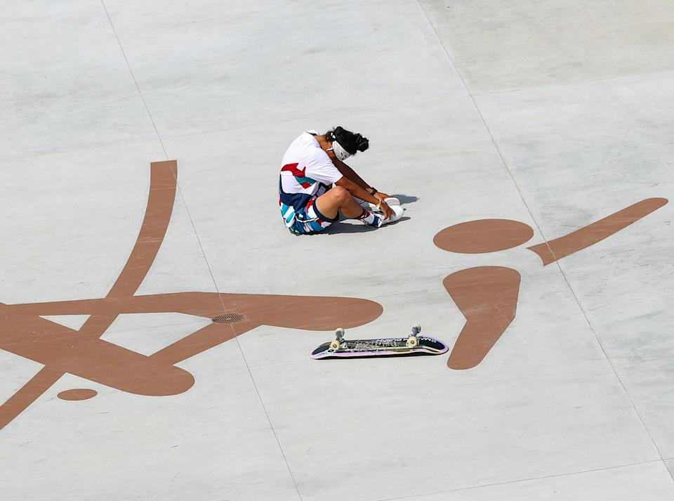 <p>Mariah Duran of the United States takes a moment after falling during the women's street preliminaries on July 26 at Ariake Urban Sports Park.</p>