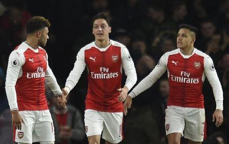 Arsenal's Mesut Ozil celebrates scoring their second goal with Alexis Sanchez and Alex Oxlade-Chamberlain