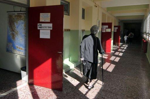 People arrive to vote at a polling station in Athens. Greece's two main pro-bailout parties have won enough votes to form a government in a cliffhanger election Sunday, first estimates showed, easing fears the stricken economy will crash out of the euro