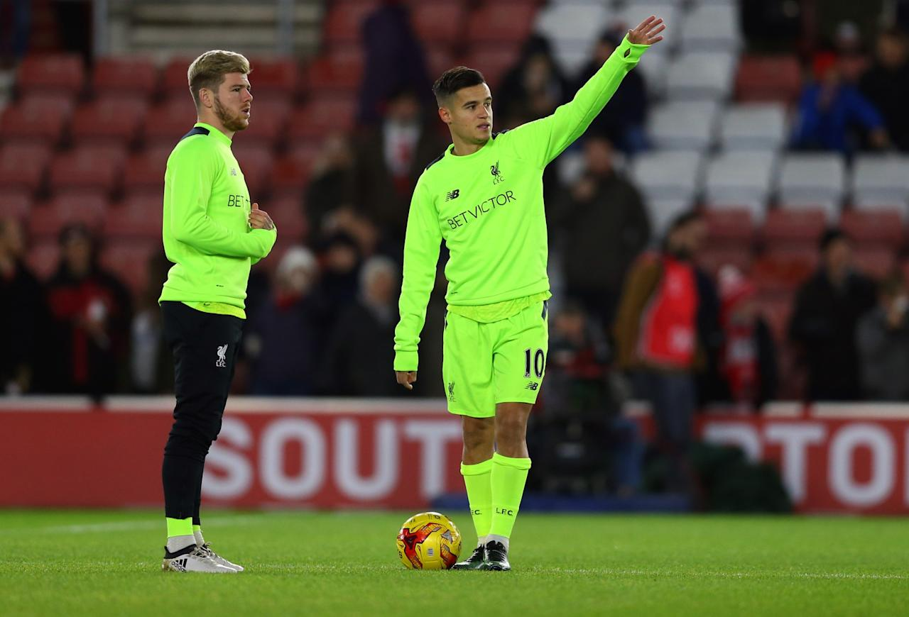 <p>Philippe Coutinho is spotted warming up before the match (Getty Images) </p>
