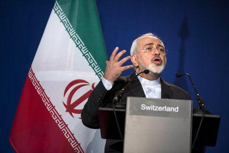 Iran's Foreign Minister Javad Zarif gestures as he speaks during a news conference in Lausanne