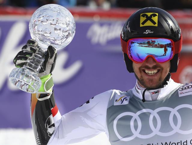 Austria's Marcel Hirscher holds the men's World Cup giant slalom discipline trophy, at the alpine ski World Cup finals in Are, Sweden, Saturday, March 17, 2018. (AP Photo/Marco Trovati)
