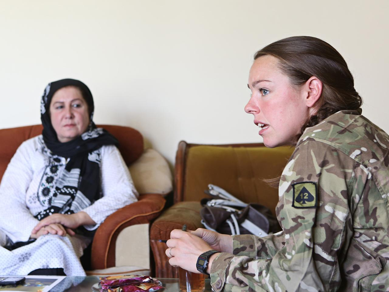 Hearts and minds: Lieutenant Jessic French, a female engagement officer, talks to an Afghan woman in an effort to gain her trust (Alison Baskerville)