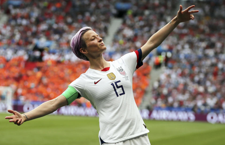 FILE - In this July 7, 2019 file photo, United States' Megan Rapinoe celebrates after scoring the opening goal from the penalty spot during the Women's World Cup final soccer match against The Netherlands at the Stade de Lyon in Decines, outside Lyon, France. Rapinoe has returned to the U.S. national team after sitting out most of last year following the SheBelieves Cup tournament, joining the squad for its January training camp in Florida. (AP Photo/Francisco Seco, File)