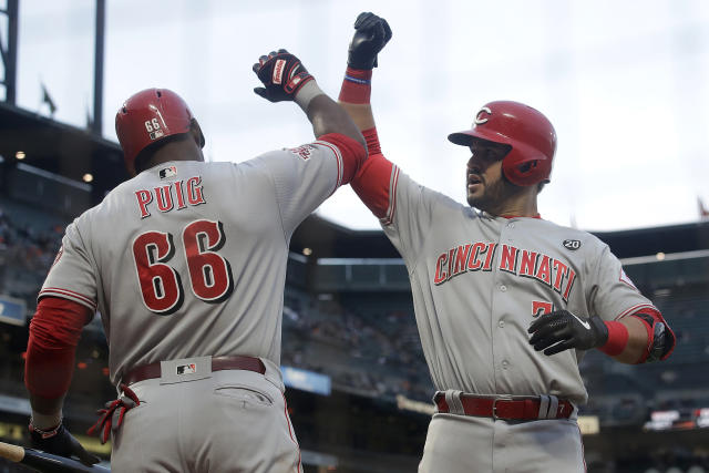 Cincinnati Reds' Eugenio Suarez, right, celebrates with Yasiel Puig after hitting a solo home run against the San Francisco Giants during the fifth inning of a baseball game in San Francisco, Saturday, May 11, 2019. (AP Photo/Jeff Chiu)