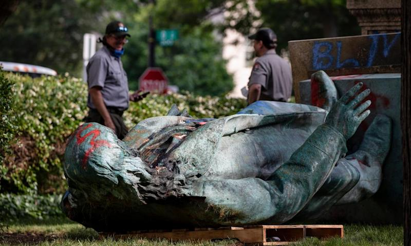 Statue of Confederate general Albert Pike after it was toppled and defaced near Judiciary Square the previous night following a day of Juneteenth celebrations in Washington DC, on 20 June.