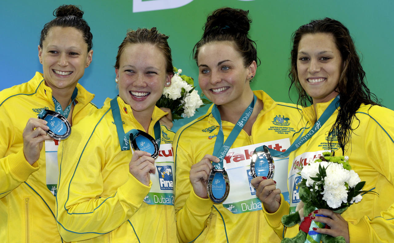 Silver medalists Blair Evans, Jade Neilsen, Kelly Stubbins and Kylie Palmer from Australia pose during the medal ceremony for the Women's 4x200 meter Freestyle Final at the FINA Short Course Swimming World Championships in Dubai, United Arab Emirates, Wednesday, Dec. 15, 2010.