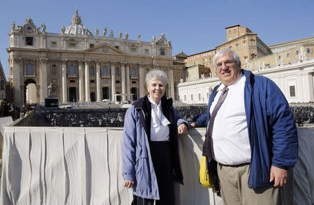 Sister Jeannine Gramick and Francis DeBernardo of New Ways Ministry, which ministers to homosexual Catholics and promotes gay rights, pose in front of St. Peter's Square after Pope Francis' weekly audience, February 18, 2015. REUTERS/Giampiero Sposito