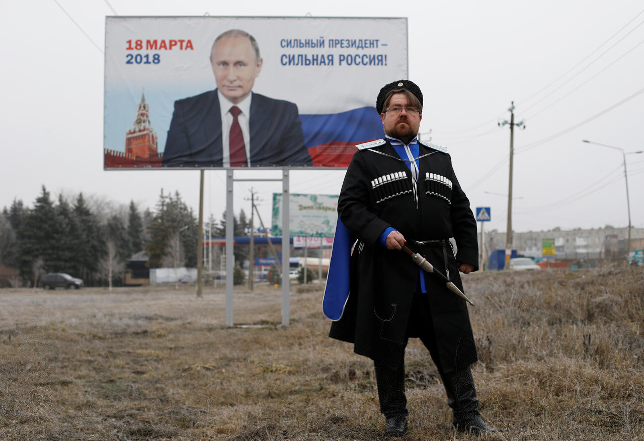 "<p>Andrei Vorontsov, 42, ataman of a local Cossack society and supporter of presidential candidate Vladimir Putin, poses for a picture in Mikhaylovsk, a town in Stavropol Region, Russia, Feb. 21, 2018. ""It's hard to say what the future will look like,"" said Vorontsov. ""The way I see it, people can make assumptions, but it's God that decides. The way He rules it, that's how things will be."" (Photo: Eduard Korniyenko/Reuters) </p>"