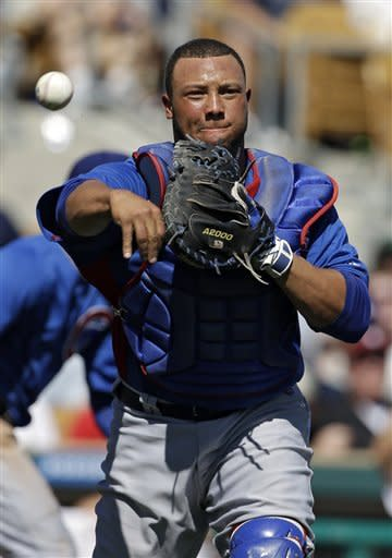 Chicago Cubs catcher Welington Castillo throws out Los Angeles Dodgers' Chris Capuano on a sacrifice bunt in the third inning of an exhibition spring training baseball game on Thursday, March 14, 2013, in Glendale, Ariz. (AP Photo/Mark Duncan)