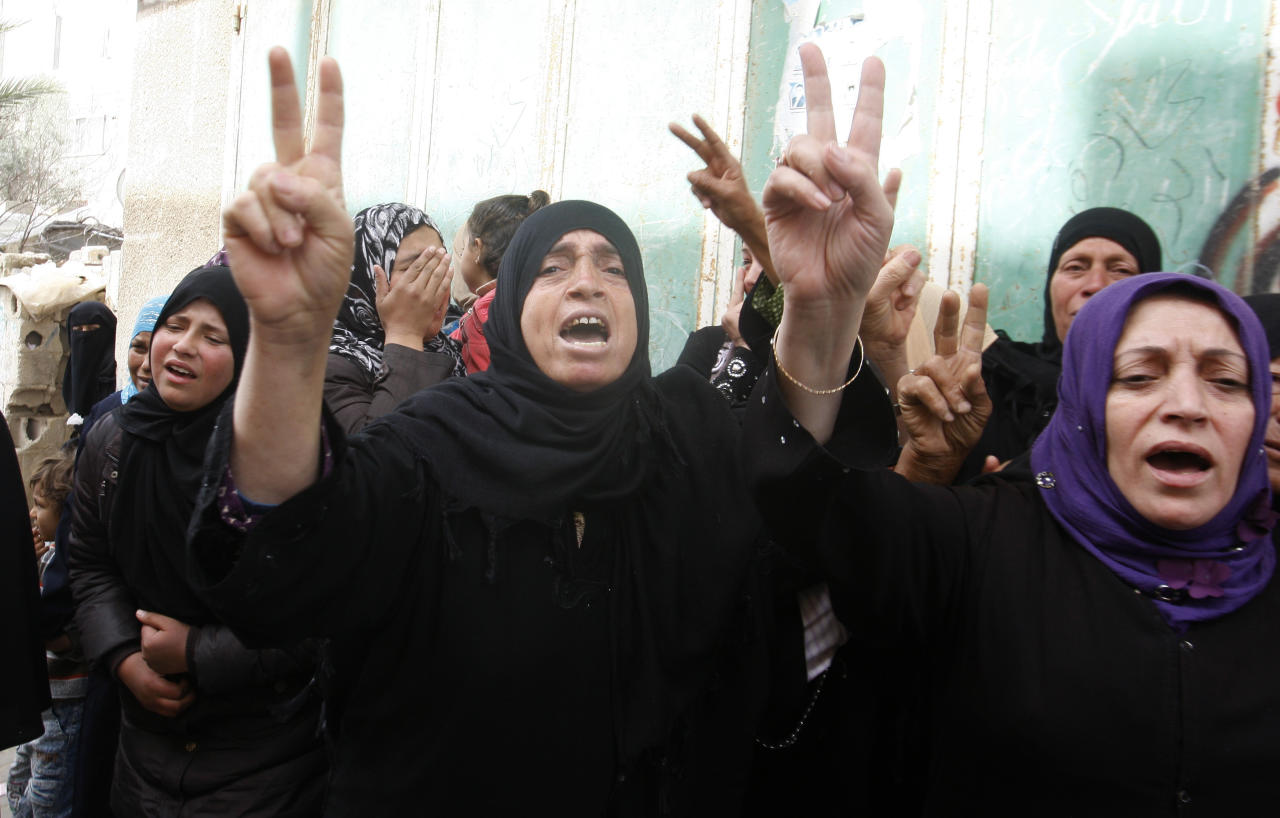 Palestinian women react during the funeral of Islamic Jihad militant Hamada Mataleg who was killed in an Israeli air strike Sunday, in Khan Younis, southern Gaza Strip, Monday, March 12, 2012. Israeli airstrikes killed two Palestinian militants and a schoolboy in the Gaza Strip on Monday and Palestinian rocket squads barraged southern Israel, in escalating fighting that has defied international truce efforts. (AP Photo/Hatem Moussa)