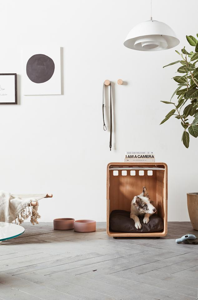 """<p>If you thought there was no such thing as a sophisticated dog crate, then it's time to reconsider: Composed of sleek bentwood, the Crate at Fable is a small dog crate&mdash;complete with dog nose-sized ventilation holes on the door&mdash;designed to look like a minimalist style side table that can blend seamlessly into any space.</p><p><em>Fable Crate with White Gate, $275, </em><a href=""""https://fablepets.com/products/crate?variant=29391884091490""""><em>fablepets.com</em></a>.</p>"""