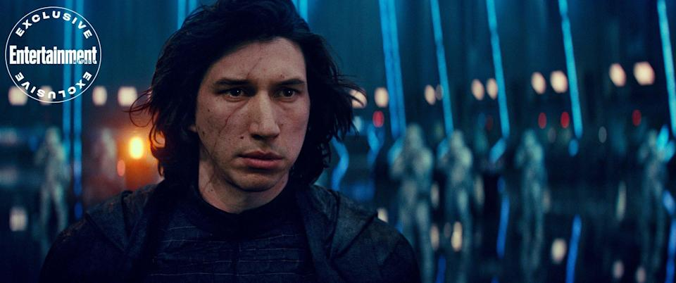 """A scarred First Order Supeme Leader Kylo Ren (<a href=""""https://ew.com/tag/adam-driver/"""" rel=""""nofollow noopener"""" target=""""_blank"""" data-ylk=""""slk:Adam Driver"""" class=""""link rapid-noclick-resp"""">Adam Driver</a>) with an array of stromtroopers."""