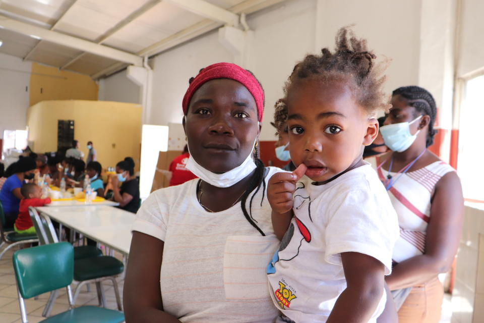 Ana Estache, from Port-au-Prince, Haiti, poses for a photo with her two-year-old son in Monterrey, Mexico, Thursday, Sept. 23, 2021, after traveling from Chile where they lived before. Estache, 43, who traveled with her husband and two children, said has considered returning to Chile, but said she still dreams of getting to the U.S. for a chance at a better life. (AP Photo/Marcos Martinez Chacon)