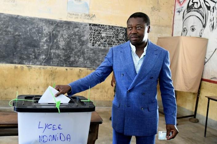 Togo's long-time leader, Faure Gnassingbe, casting his vote in presidential elections in February
