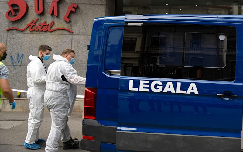 Forensic workers arrive to collect evidence from a hotel in downtown Bucharest, in Romania. Gholamreza Mansouri, a former judge from Iran sought by his country to face corruption charges, has died after falling from a high floor - AP