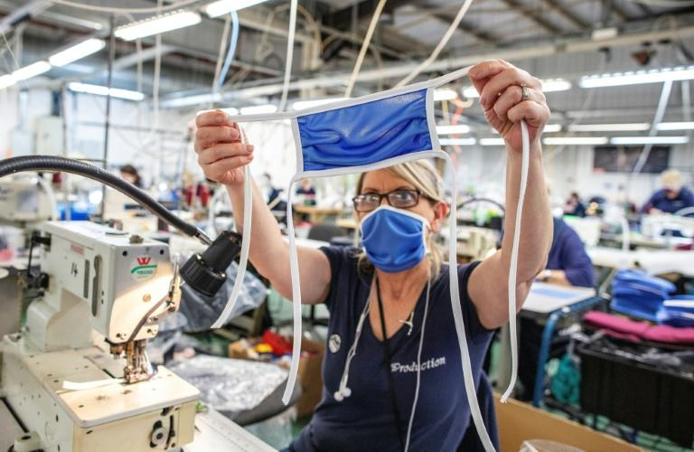 A sportswear factory in Northern Ireland is now producing scrubs for local operations of Britain's health service (AFP Photo/Paul Faith)