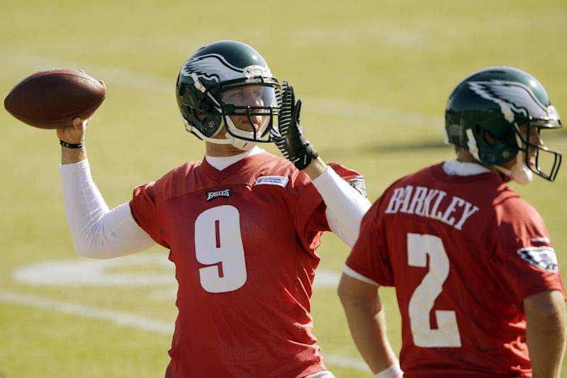 Philadelphia Eagles quarterback Nick Foles, left, throws a pass as quarterback Matt Barkley looks on during practice at the NFL football team's training facility, Tuesday, Oct. 29, 2013, in Philadelphia. (AP Photo/Matt Rourke)