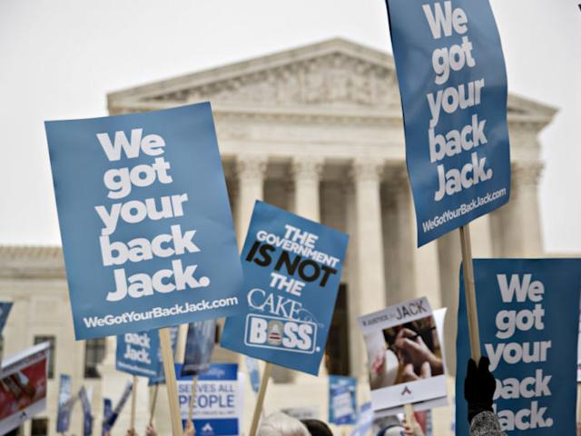 Demonstrators hold signs in support of Masterpiece Cakeshop owner Jack Phillips outside the U.S. Supreme Court during arguments in the Masterpiece Cakeshop v. Colorado Civil Rights Commission case in Washington, D.C., U.S., on Tuesday, Dec. 5, 2017. A pivotal justice sent mixed messages as the Supreme Court heard arguments in the case of a Colorado baker who refuses to make cakes for same-sex weddings. The state has ordered him to either make cakes for gay weddings or stop making wedding cakes at all. Photographer: Andrew Harrer/Bloomberg via Getty Images