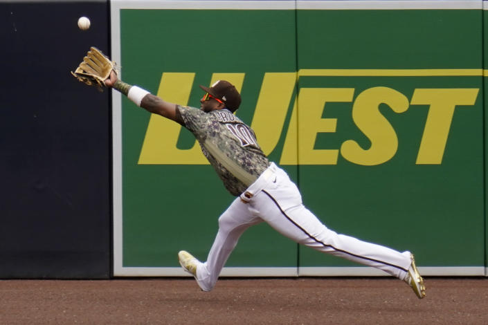San Diego Padres left fielder Jurickson Profar makes the catch for the out on San Francisco Giants' Mike Tauchman during the first inning of a baseball game Sunday, May 2, 2021, in San Diego. (AP Photo/Gregory Bull)