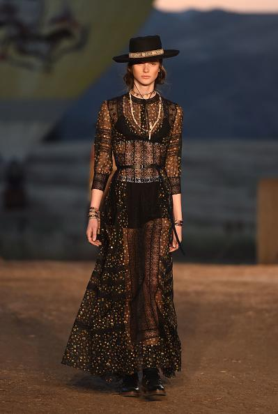 <p>Another model in a dress and a bolero walks the runway during the first cruise collection by Maria Grazia Chiuri for Dior show in Calabasas, Calif. (Photo: Getty Images) </p>