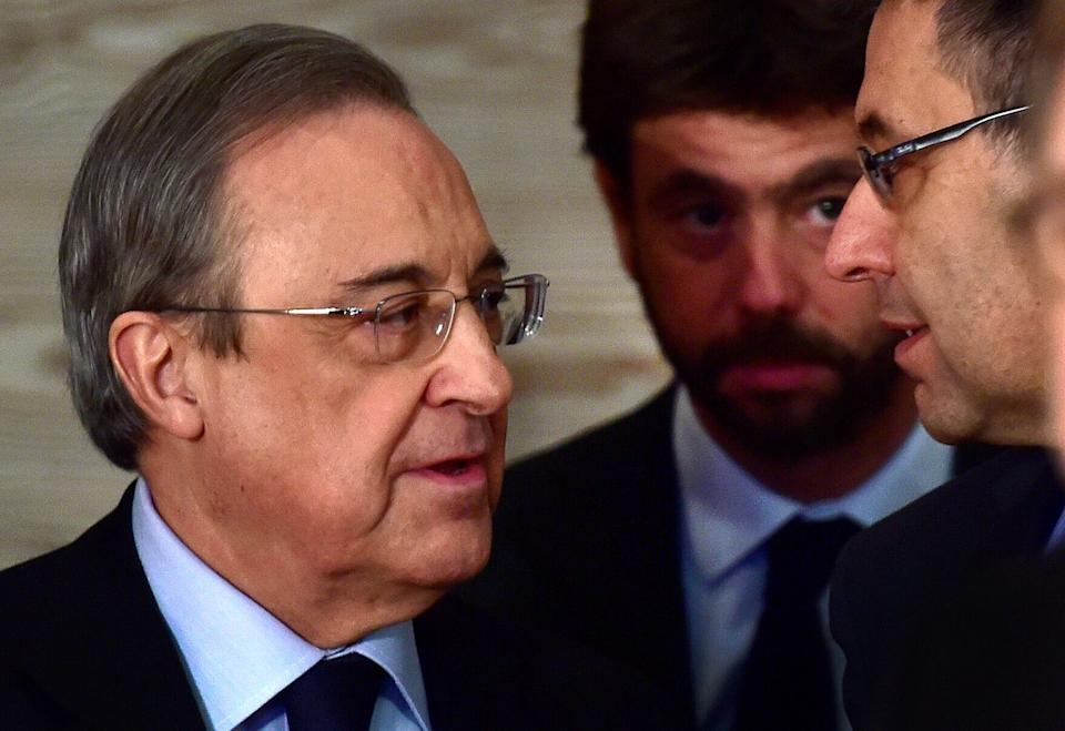 "Real Madrid President Florentino Perez (L), Juventus FC President Andrea Agnelli (C) and Barcelona President Josep Maria Bartomeu (R) wait before the presentation of a PRISA and UNESCO awarness campaign dubbed ""Sin respeto no hay juego"" (No respect no game) at Madrid Traje museum in Madrid on January 24, 2017 whose objective is to ""fight discrimination and racism in football in Spain and Latin America"". / AFP / GERARD JULIEN        (Photo credit should read GERARD JULIEN/AFP via Getty Images) (Photo: GERARD JULIEN via Getty Images)"