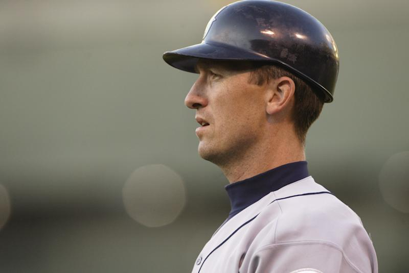 OAKLAND, CA - APRIL 9: John Olerud #5 of the Seattle Mariners looks on during the game against the Oakland A's on April 9, 2004 at Network Associates Coliseum in Oakland, California. The A's won 8-6. (Photo by Stephen Dunn/Getty Images)