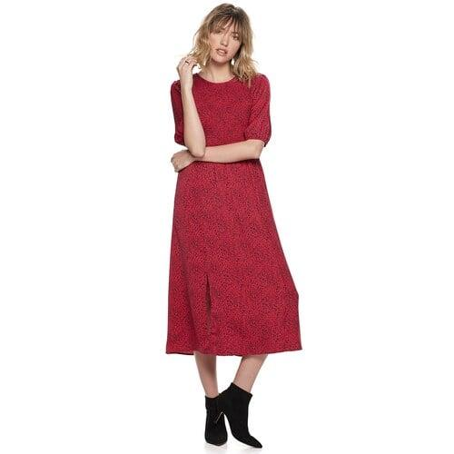 """<p>""""A midi dress is so flattering, and the ruching detail on this <a href=""""https://www.popsugar.com/buy/POPSUGAR-Smocked-Bodice-Midi-Dress-521079?p_name=POPSUGAR%20Smocked%20Bodice%20Midi%20Dress&retailer=kohls.com&pid=521079&price=68&evar1=fab%3Aus&evar9=46947571&evar98=https%3A%2F%2Fwww.popsugar.com%2Fphoto-gallery%2F46947571%2Fimage%2F46947594%2FPOPSUGAR-Smocked-Bodice-Midi-Dress&list1=popsugar%20at%20kohls&prop13=api&pdata=1"""" rel=""""nofollow"""" data-shoppable-link=""""1"""" target=""""_blank"""" class=""""ga-track"""" data-ga-category=""""Related"""" data-ga-label=""""https://www.kohls.com/product/prd-3940226/womens-popsugar-smocked-bodice-midi-dress.jsp?color=Granita%20Leopard&amp;prdPV=4"""" data-ga-action=""""In-Line Links"""">POPSUGAR Smocked Bodice Midi Dress</a> ($68) creates a perfect fit for all body types. I can't wait to pair mine with lace-up boots at work and taller knee-high boots for a holiday party.""""</p>"""