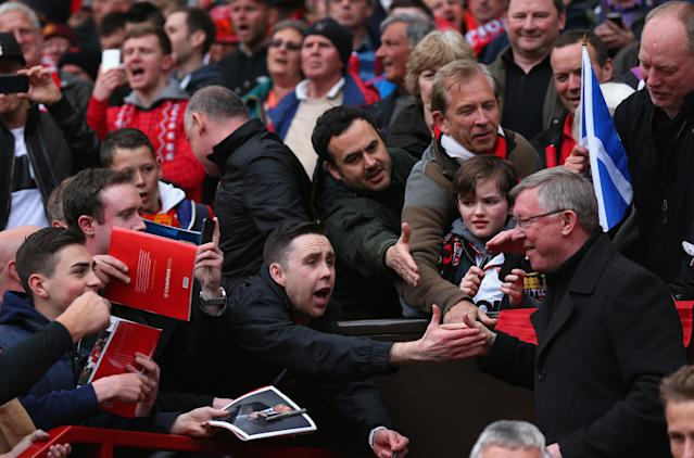 MANCHESTER, ENGLAND - MAY 12: Manchester United Manager Sir Alex Ferguson shakes hands with fans prior to the Barclays Premier League match between Manchester United and Swansea City at Old Trafford on May 12, 2013 in Manchester, England. (Photo by Alex Livesey/Getty Images)