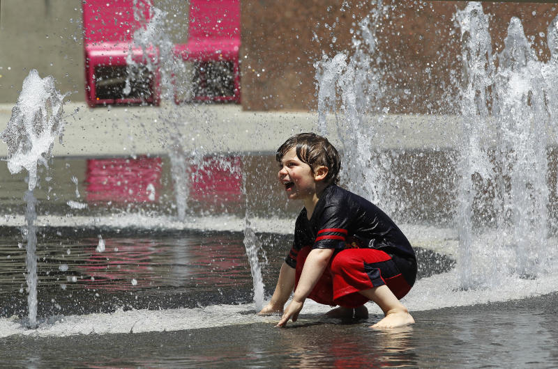 Thijs Talluto, 3, of Los Angeles, plays in a fountain at Grand Park in downtown Los Angeles Monday, May, 12, 2014. A warm weekend gave way to a sweltering work week in Southern California, with whipping winds of the sort already felt across the West bringing dry conditions and high fire danger. After a hot, windy Mother's Day with temperatures in the mid-80s, a high pressure system was expected to heighten the heat slightly Monday before pushing it to near triple digits in some spots midweek, mostly inland areas already badly parched by drought. High temperatures will extend up and down California, according to the National Weather Service.(AP Photo/Nick Ut )