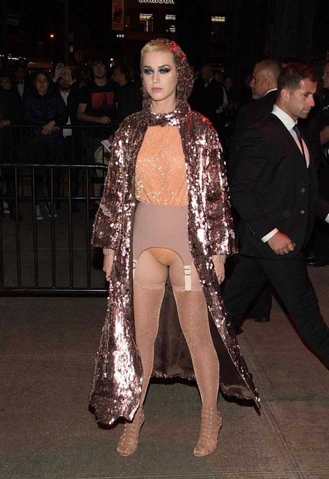 <p>Katy continued her risk-taking, changing into a leotard and hooded sequinned coat.<br /><i>[Photo: Getty]</i> </p>