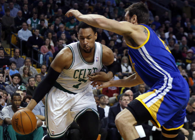 Boston Celtics center Jared Sullinger (7) drives against Golden State Warriors center Andrew Bogut in the first half of an NBA basketball game in Boston, Wednesday, March 5, 2014. (AP Photo/Elise Amendola)