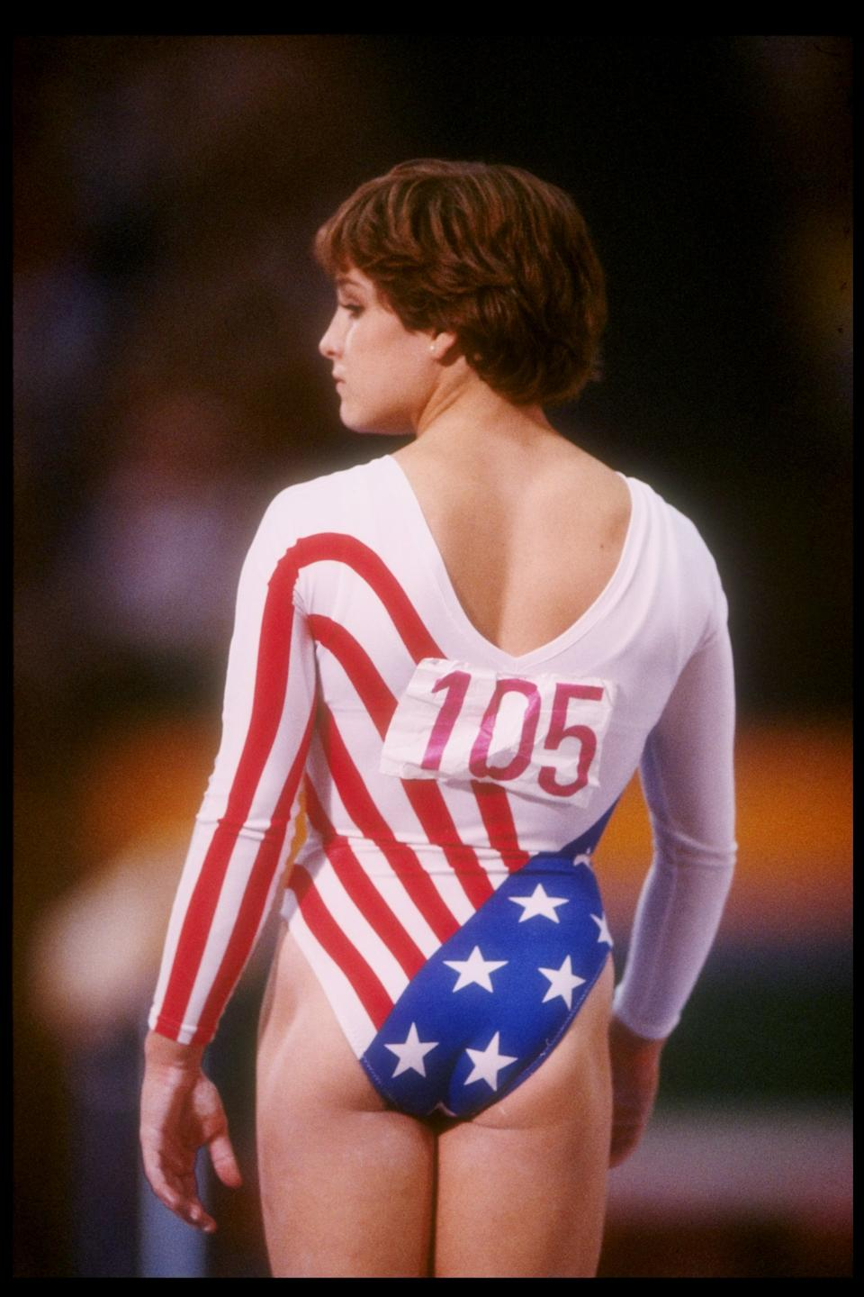3 Aug 1984: Mary Lou Retton of the United States looks on during the women''s all-around competition at the Summer Olympics in Los Angeles, California. Retton won the gold medal in the event. Mandatory Credit: Steve Powell /Allsport