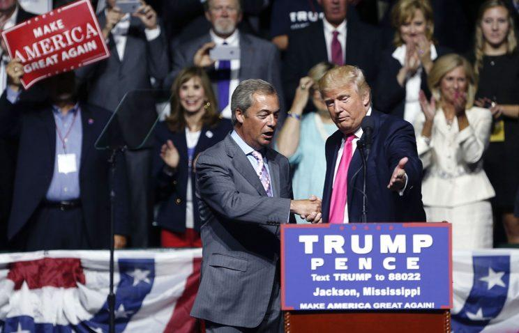 Donald Trump welcomes Nigel Farage, ex-leader of the U.K. Independence Party, at a campaign rally in Jackson, Miss. (Photo: Gerald Herbert/AP)
