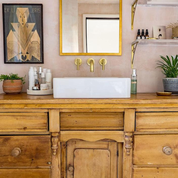 "<div class=""caption""> <strong>AFTER:</strong> The wood vanity in the former laundry room turned bathroom oasis. </div> <cite class=""credit"">Ulf Bjorlin</cite>"