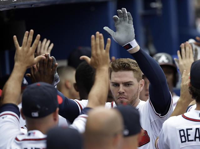Atlanta Braves first baseman Freddie Freeman celebrates after hitting a three-run home run in the second inning of a baseball game against the New York Mets, Monday, Sept. 2, 2013, in Atlanta. (AP Photo/John Bazemore)