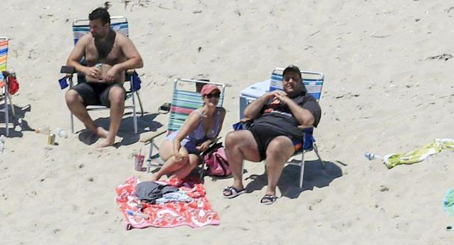 New Jersey Gov. Chris Christie, right, enjoys enjoys the beach with family and friends near his summer house at Island Beach State Park, July 2, 2017. (Photo: Andrew Mills/NJ Advance Media via AP)