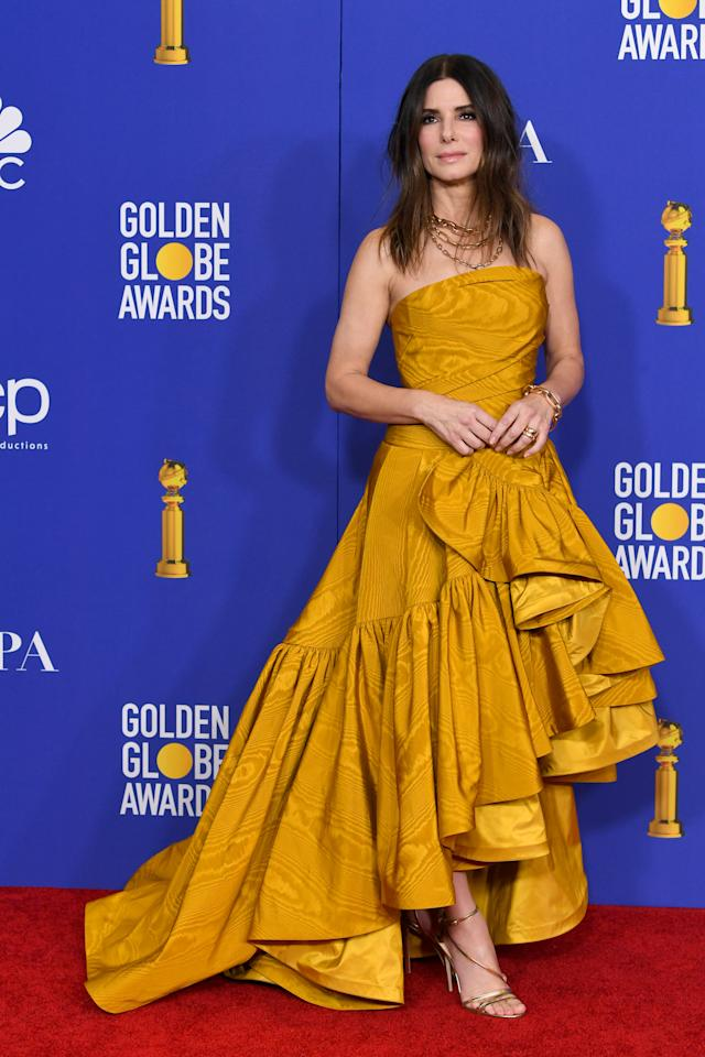 "Bullock surprised viewers as she took the stage as a presenter in a marigold Oscar de la Renta gown. The 55-year-old star presented the final award to ""1917"" director Sam Mendes for Best Motion Picture in a Drama. (Photo by Kevin Winter/Getty Images)"