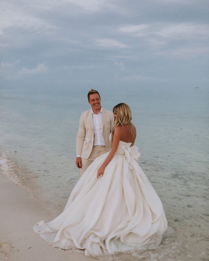 """<p>The trip also included a vow renewal ceremony between Kim and Kroy. She wore a very beach-appropriate ball gown for the event, while he sported a tan suit. They hung out in the surf, letting the sand and salt water destroy the bottom of her dress. """"<span title=""""Edited"""">I think he loves me photo by <a href=""""https://www.instagram.com/samlandrethphoto/"""" rel=""""nofollow noopener"""" target=""""_blank"""" data-ylk=""""slk:@samlandrethphoto"""" class=""""link rapid-noclick-resp"""">@samlandrethphoto</a>,"""" Kim wrote.</span> (Photo: <a href=""""https://www.instagram.com/p/BU9fHPoh6MT/"""" rel=""""nofollow noopener"""" target=""""_blank"""" data-ylk=""""slk:Kim Zolciak-Biermann via Instagram"""" class=""""link rapid-noclick-resp"""">Kim Zolciak-Biermann via Instagram</a>) </p>"""