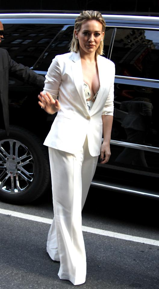 <p>The <i>Younger </i>actress hit the <i>Today Show </i>looking particularly sleek and chic in a white Theory suit, which she paired with a sexy printed Zimmermann bustier. Duff's slicked back golden locks paired perfectly with the ensemble. <i>Photo: Splash</i> </p>