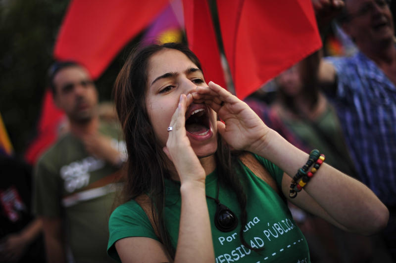 Carmen, 22, a Spanish teenage student of a public university, calls for a general strike as she protests against cutback plans by Spain's government  in Pamplona, northern Spain, Thursday, July 19, 2012. (AP Photo/Alvaro Barrientos)