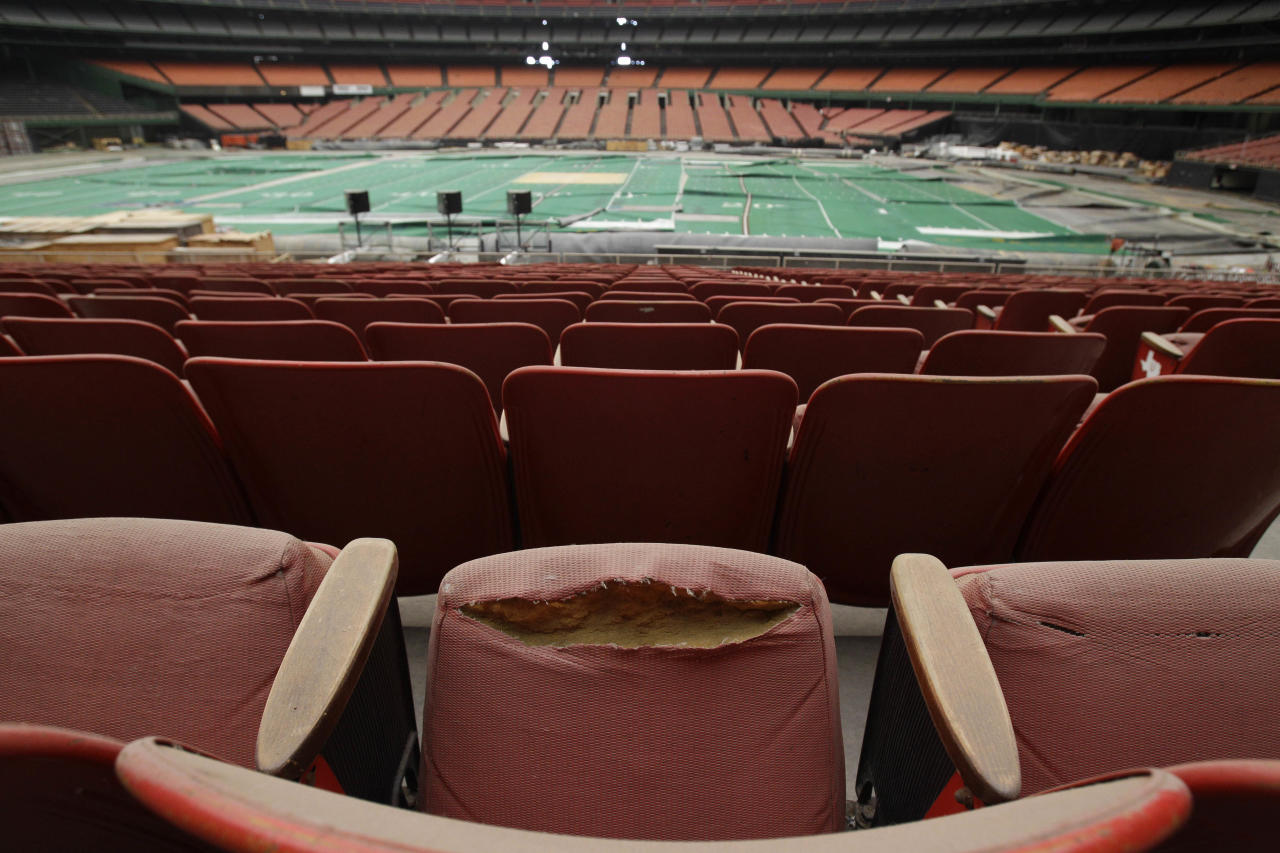 Rows of dirty, tattered seats ring the Astrodome Monday, May 21, 2012, in Houston. Once touted as the Eighth Wonder of the World, the nation's first domed stadium sits quietly gathering dust and items for storage. (AP Photo/Pat Sullivan)