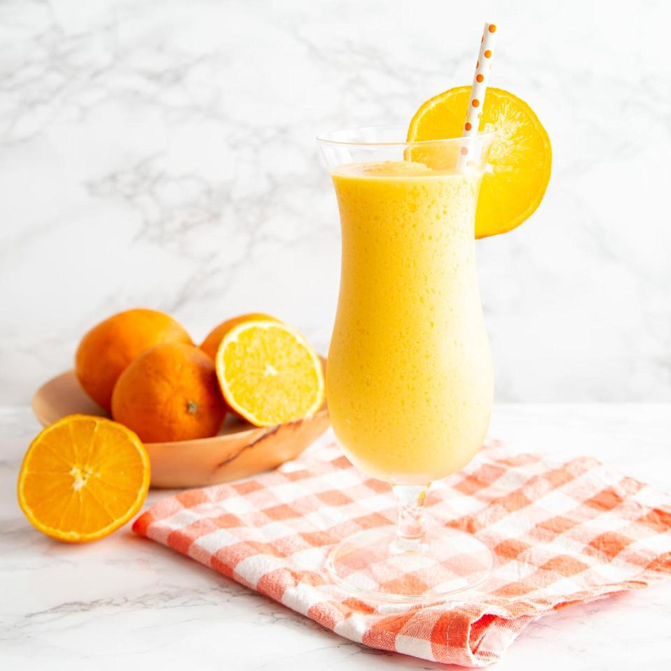 <p>For those of you who always loved to run to the curb to buy a little bit of summer on a stick, this drink is right up your alley. The secret to the straight-from-the-ice-cream truck taste of this creamy frozen treat? Double the fruit! A little bit of frozen mango helps thicken the drink naturally in the blender while boosting the juicy flavor of fresh orange juice. Unsweetened vanilla coconut milk brings just a hint of sweetness while keeping this added-sugar-free and vegan. You could also use a sweetened coconut milk if you prefer a little more sweetness. Enjoy this refreshing and nostalgic drink on its own, or add a splash of your favorite vodka or rum for a summer happy hour indulgence. P.S.: Unlike the ice cream version, this one travels well in an insulated cup if you want to take it poolside!</p>