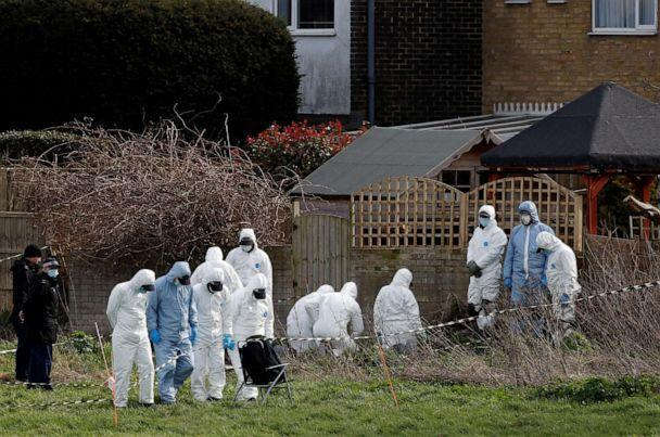 PHOTO: Police officers search an area of grass land behind a house, as the investigation into the disappearance of Sarah Everard continues, in Deal, Britain, March 12, 2021. (Paul Childs/Reuters)