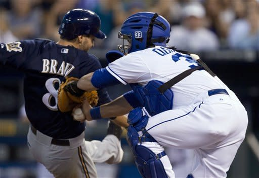 Kansas City Royals catcher Humberto Quintero tags out Milwaukee Brewers' Ryan Braun (8) during the seventh inning of a baseball game at Kauffman Stadium in Kansas City, Mo., Tuesday, June 12, 2012. (AP Photo/Orlin Wagner)