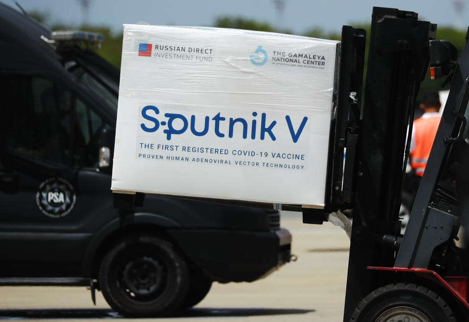 EZEIZA, ARGENTINA - JANUARY 16: A container carrying part of the second batch of 300,000 doses of Sputnik V vaccine is moved by a forklift after it's arrival from Russia at Ministro Pistarini International airport on January 16, 2021 in Ezeiza, Argentina. The 30,000 Sputnik V doses of Ad5 component will be applied as a second dose to the health personnel and first line workers that already received the Ad26 first dose explained Vice Minister of Health Carla Vizzotti. (Photo by Marcos Brindicci/Getty Images)