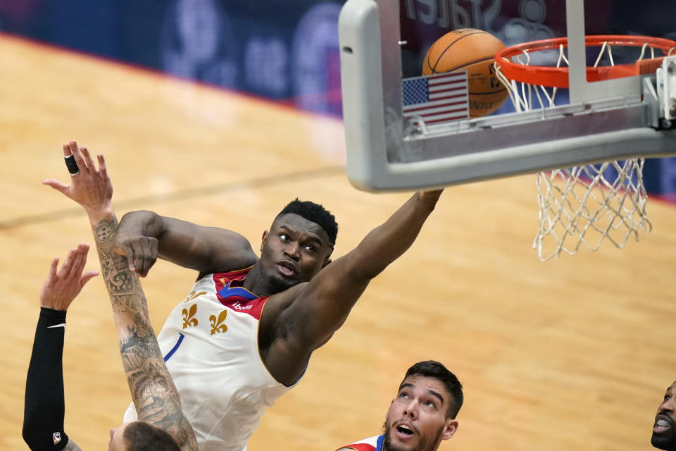 New Orleans Pelicans forward Zion Williamson (1) goes to the basket in the first half of an NBA basketball game against the Boston Celtics in New Orleans, Sunday, Feb. 21, 2021. (AP Photo/Gerald Herbert)